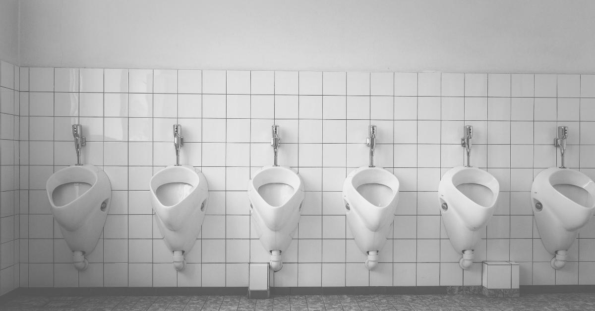 stadium bathrooms row of urinals